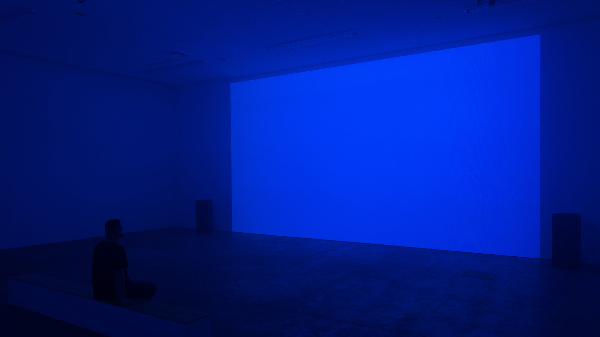 Repose Installation (blue with figure sitting on bench)